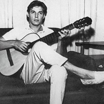 brazilian bossa nova composer wearing his alpargatas-espardrilles while playing gitar