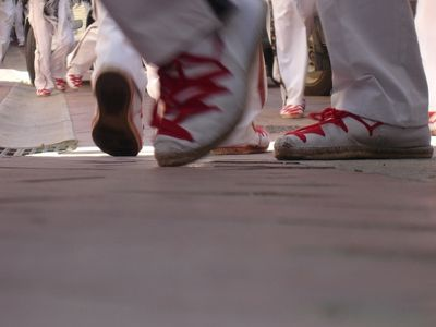 men wearing red and white alpargatas-espardrilles in the spanish village of La Rioja