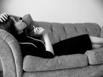 brasilian singer astrud gilberto laying down on a sofa