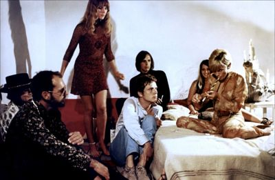 more 1969 party scene smoking marihuana in a pipa