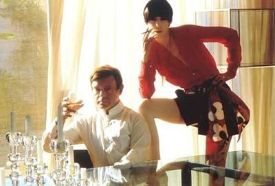 fashion model peggy moffitt and fashion designer gerneich posin together
