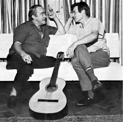 carlos jobim and vinicius de moraes chatting on a sofa