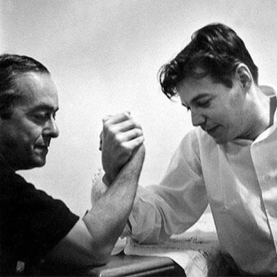 brazilian musicians Tom Jobim and Vinicius de Moraes arm wrestling