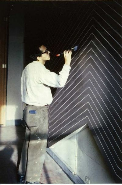 abstract minimalist artist frank stella brush paintin in his new york studiov
