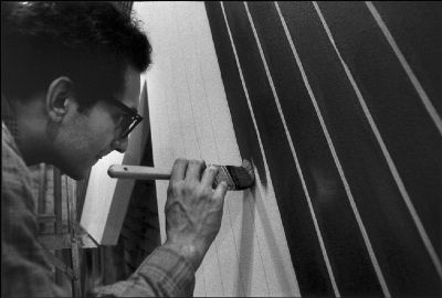 modern american artist frank stella brush painting in his new york studio