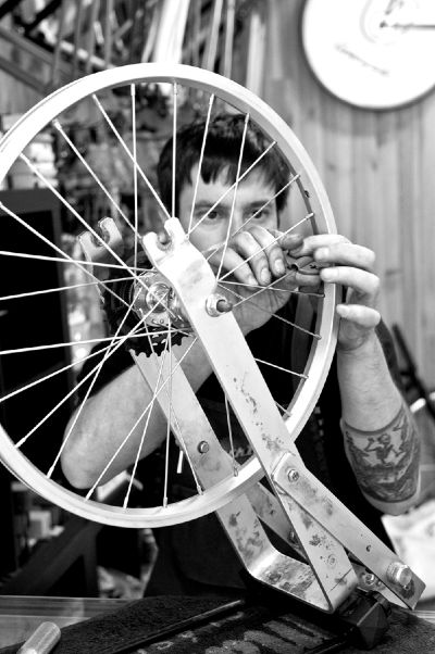men at work on a custon made bike in madrid