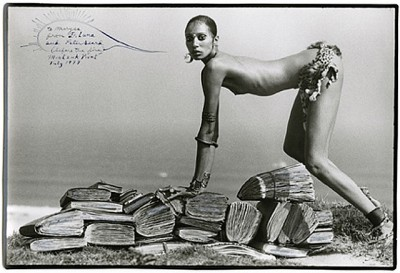 topless woman on top of antique books Peter Beard