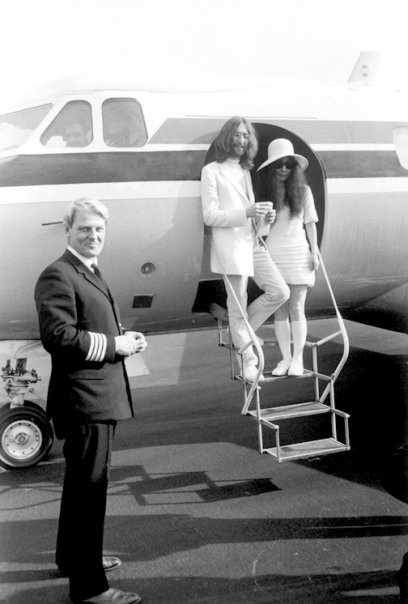 john lennon and yoko ono in spring cour shoes at aiplane stairs