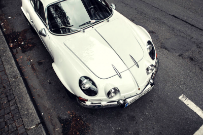 white RENAULT ALPINE A110 on the road