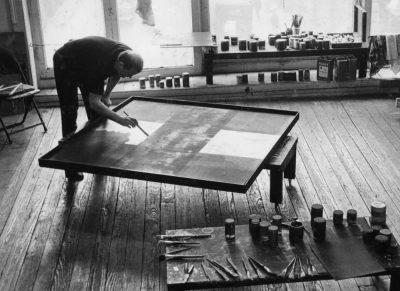 Ad Reinhardt painting at his studio