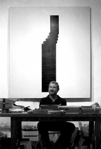 Carl Van der Voort at his desk in his gallery ibiza