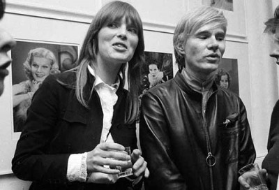 nico with andy warhol at an art show opening