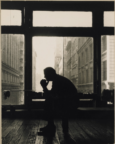 artist AD REINHARDT thinking at studio new york