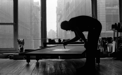 artist AD REINHARDT at work in his studio new york