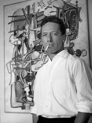 Heinz Trökes next to one of his artworks