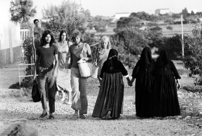 IBIZA-HIPPIES walking and crossing local ederly women 1970