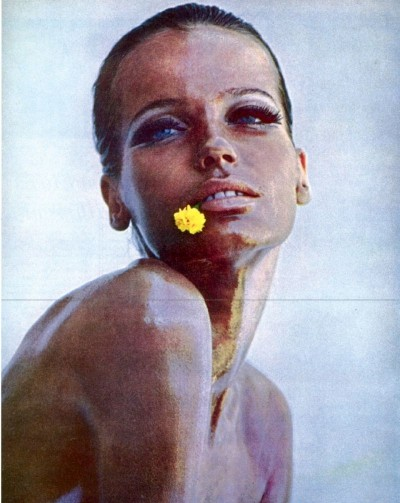 Veruschka close up portrait flower on lips