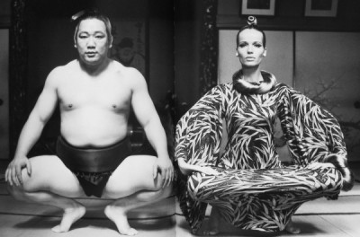 Veruschka posing next to a sumo wrestler