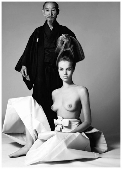Veruschka posing topless next to a japanese elder man