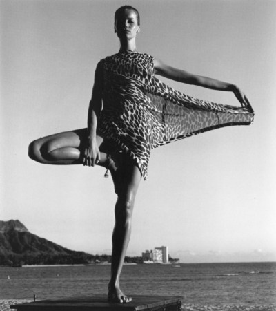 Veruschka standing on one leg posing for a fashion editorial