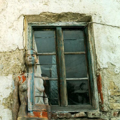 Veruschka body painting blending into a window