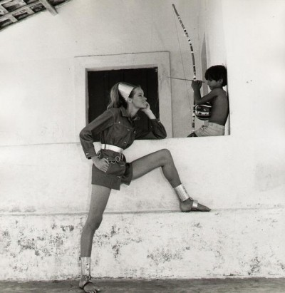 Veruschka in brasil next to a kid with brimbao cappoeira music instrument