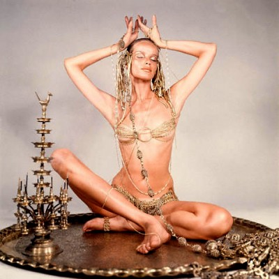 Veruschka yoga pose on a gold tray