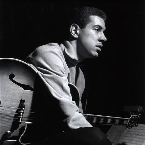 kenny burrell with a partiture