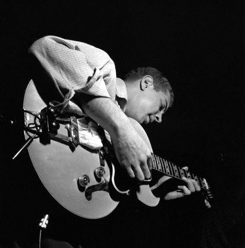 kenny burrell playing guitar in concert