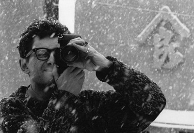nicolas bouvier taking a photograph under the snow