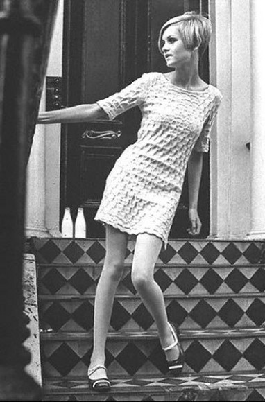 top model twiggy wearing an outfit by mary quant on a london's building stairs