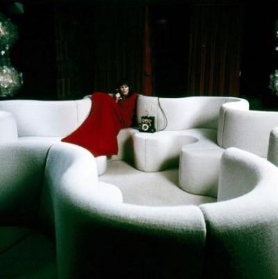 verner panton white sofa with a model in a red dress