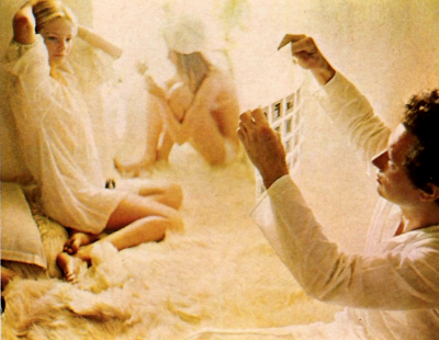 david hamilton checking photo contact sheet with models