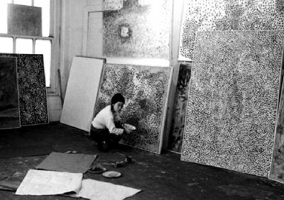 kusama at work in her studio squatting