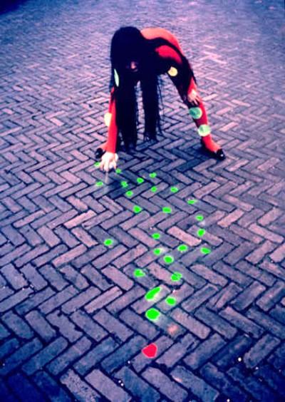 kusama painting the street pavement street intervention