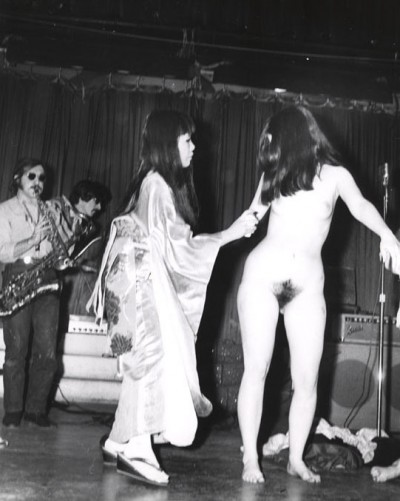 artist yayoi kusama panting dots on woman during her Body Festival New York 1967