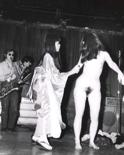 artist yayoi kusama panting dots on woman during her Body Festival New York 1967
