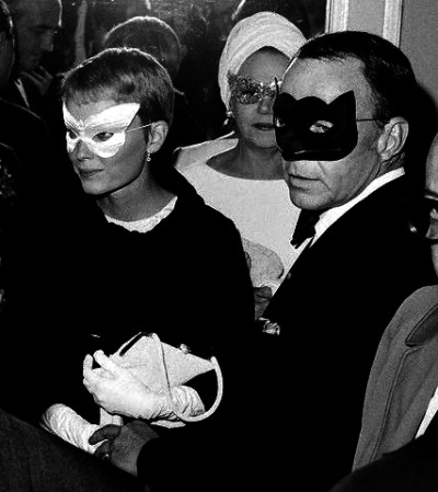 Frank Sinatra and Mia Farrow Wearing Masks