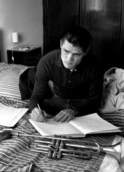 chet baker Writing Music on a hotel bed