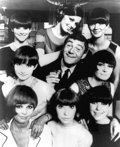 Vidal Sassoon surronded by female models