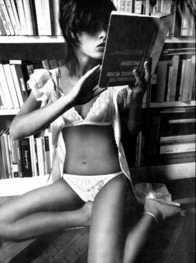 Uschi Obermaier reading a book sexy outfit