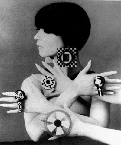 model peggy moffit sitting with accessories