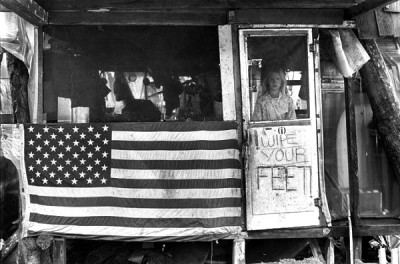 3_Taylor_camp_hawaii_hippy_ teen ager girl with american flag in a tree house