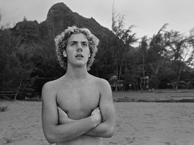 8_Taylor_camp_hawaii_surfer arms crossed on the beach