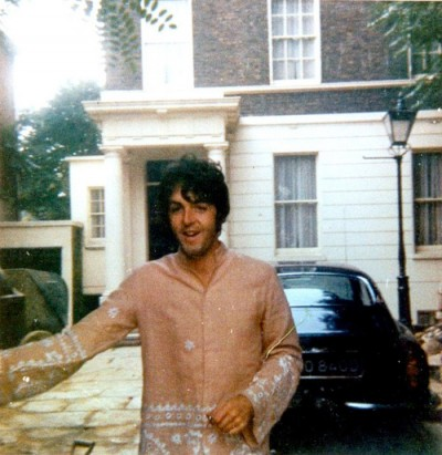 paul maccartney at the gate of his mannor