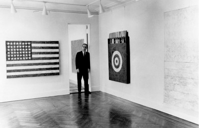 leo castelli in his new york gallery with jasper johns artworks on the wall