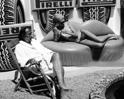 sapnish painter salvador dali at home in a white rob